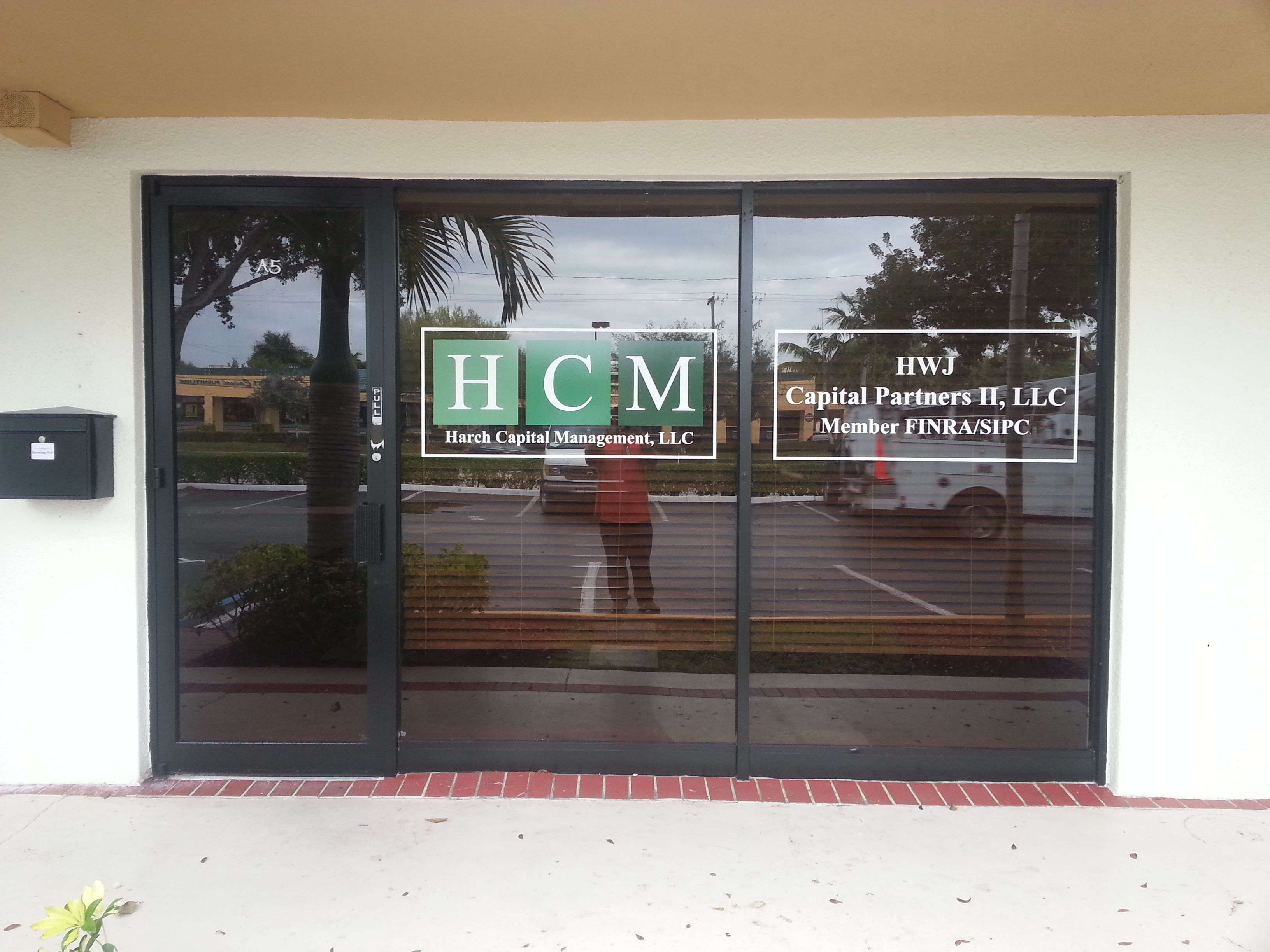 Custom Window Graphic Signage and Tinting in Boca Raton  FL for Harch  Capital Management. Custom Window Graphic Signage and Tinting in Boca Raton  FL for