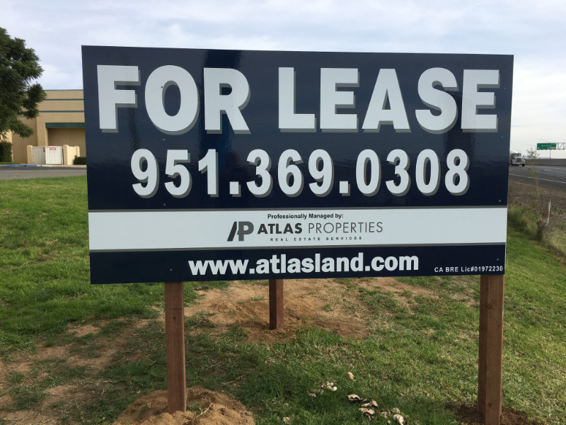 "commercial property ""For Sale"" signs"