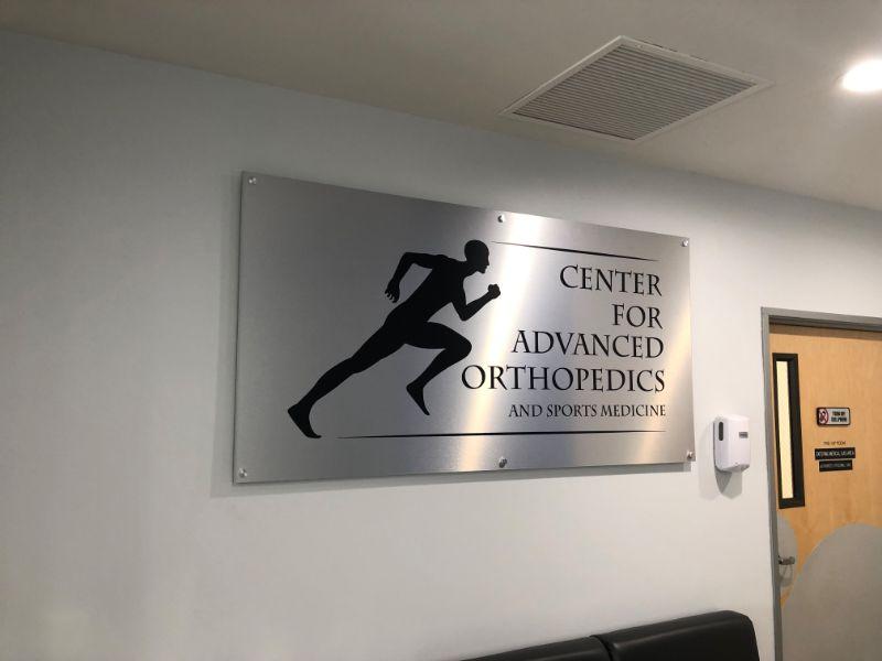 brushed aluminum lobby logo signs