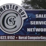 Wall signs denote where the business is located and what they have to offer.