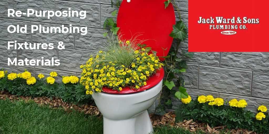 Toilet plumbing fixture used to plant flowers in re-purposing for a beautiful garden
