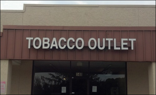 Illuminated Outdoor Led Building Sign For The Tobacco Outlet In Zebulon North Carolina