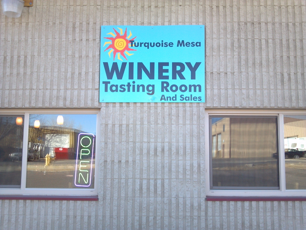 Sign for turquoise mesa winery s new location broomfield co